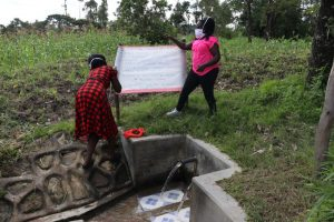 The Water Project:  The Facilitators Mounting The Chart To The Poles