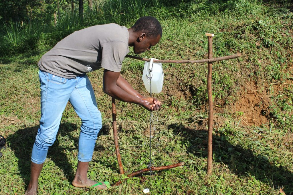 The Water Project : covid19-kenya18164-using-handsfree-handwashing-station