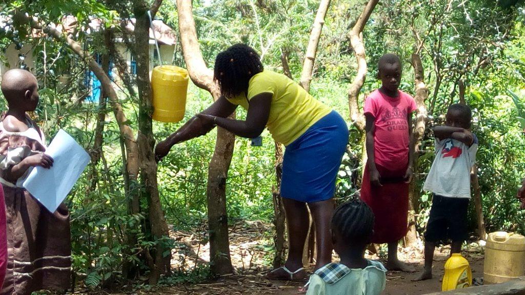 The Water Project : covid19-kenya18286-handwashing-demonstration