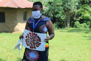The Water Project:  Facilitator Using A Visual Aid At The Training