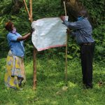 The Water Project: Ilala Community, Arnold Johnny Spring -  Installing Reminder Chart At The Spring