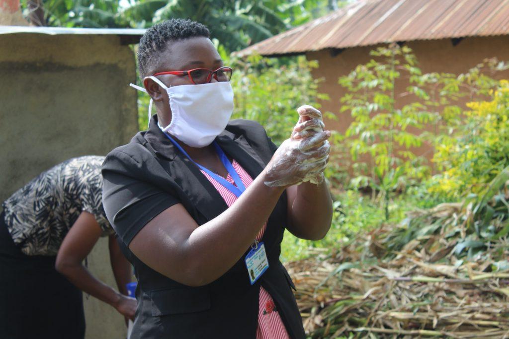 The Water Project : covid19-kenya19089-the-facilitator-leading-the-handwashing-demonstration