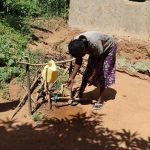 The Water Project: Emulakha Community, Nalianya Spring -  A Community Member Making Use Of The Handwashing Station