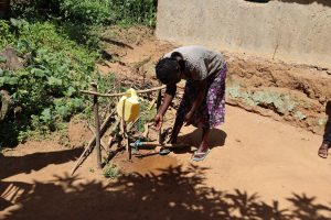 The Water Project:  A Community Member Making Use Of The Handwashing Station