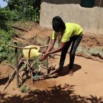 The Water Project: Emulakha Community, Nalianya Spring -  Ms Gladys Using The Handwashing Station