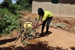 The Water Project:  Ms Gladys Using The Handwashing Station