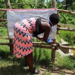 The Water Project: Emulakha Community, Nalianya Spring -  Ms Jemimah Erecting The Chart To The Fence