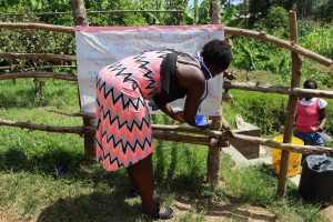 The Water Project:  Ms Jemimah Erecting The Chart To The Fence
