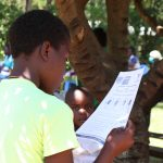 The Water Project: Sambuli Community, Nechesa Spring -  Using Handouts At The Training