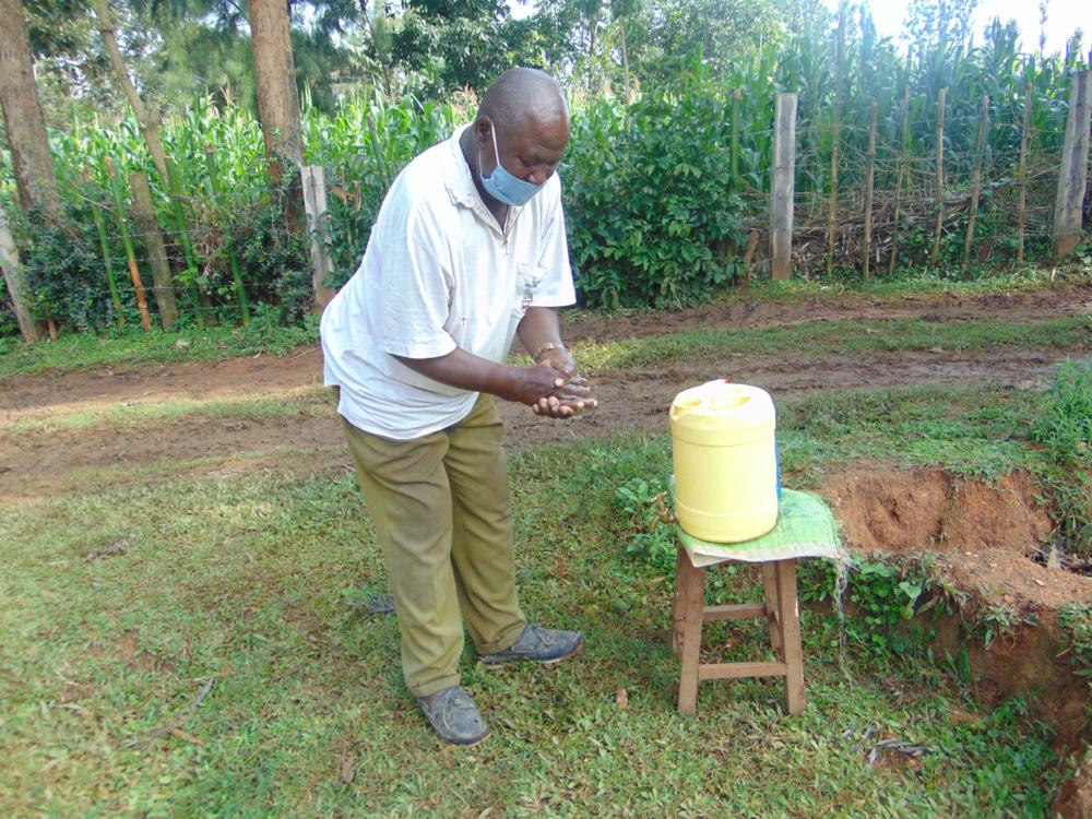 The Water Project : covid19-kenya19113-an-elderly-man-handwashing