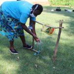 The Water Project: Emukangu Community, Okhaso Spring -  Handwashing Using The Installed Handwashing Point