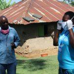 The Water Project: Emukangu Community, Okhaso Spring -  Instruction On Proper Mask Wearing