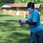 The Water Project: Emukangu Community, Okhaso Spring -  Mask Making Demonstration