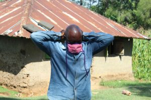 The Water Project:  Village Elder Tries On His New Mask