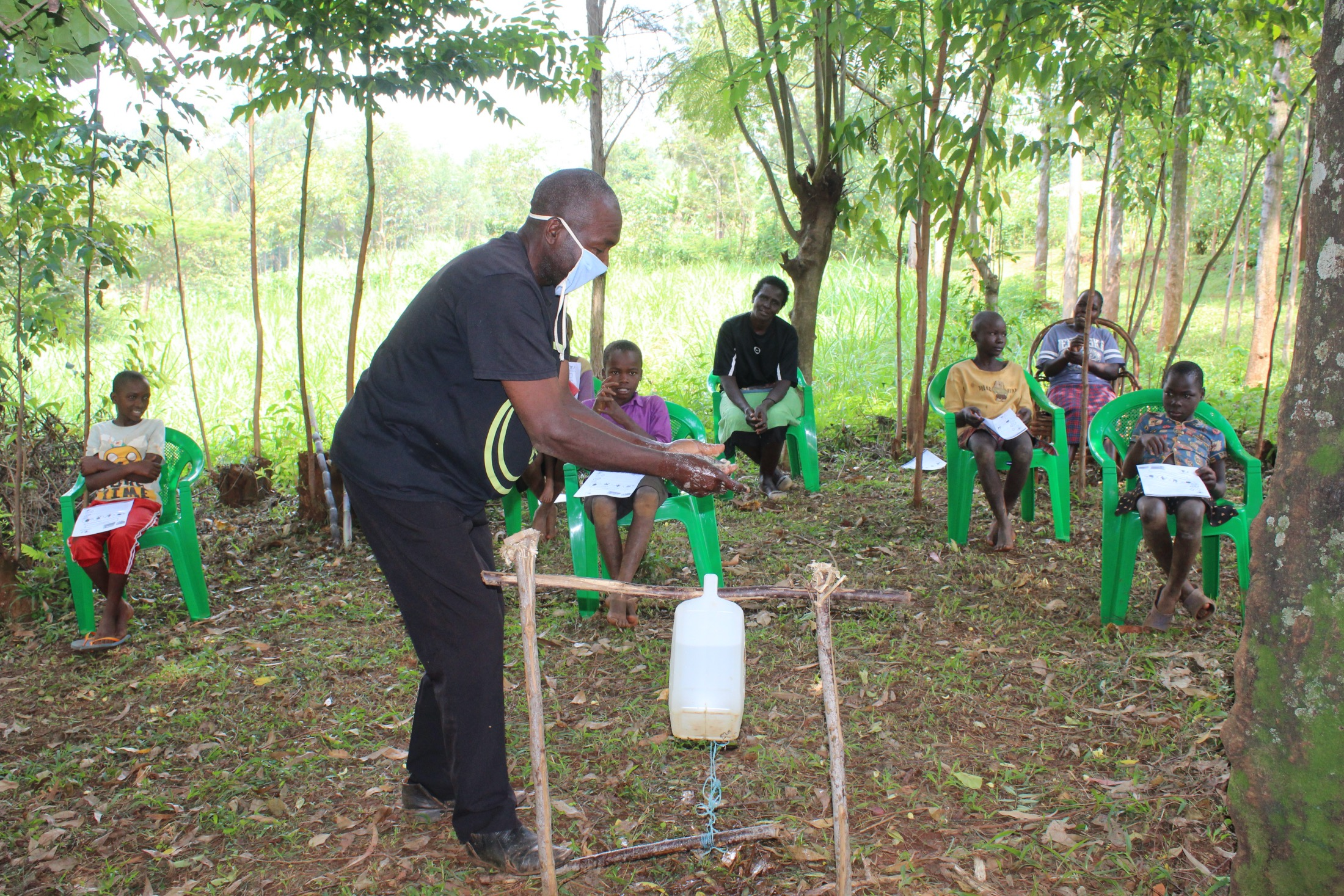 The Water Project : covid19-kenya19130-a-gent-making-use-of-the-handwashing-station