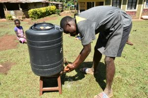 The Water Project:  A Handwaashing Tank In A Community Household