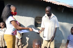 The Water Project:  Distributing Handouts About Coronavirus