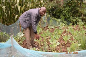 The Water Project:  Niskson At His Kitchen Garden A Product Of Ombalasi Spring