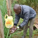 The Water Project: Emukoyani Community, Ombalasi Spring -  Niskson Washing Hands With Soap And Water