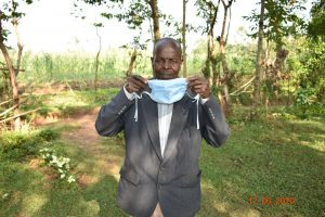 The Water Project:  David Kweyu Shows How He Puts On His Mask