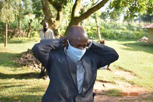 The Water Project:  David Kweyu Puts On His Mask