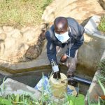 The Water Project: Eshiakhulo Community, Kweyu Spring -  David Kweyu Fetching Water