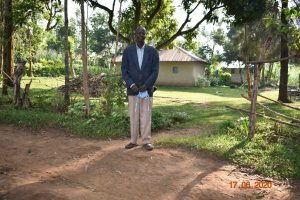 The Water Project:  David Kweyu Outside His Home