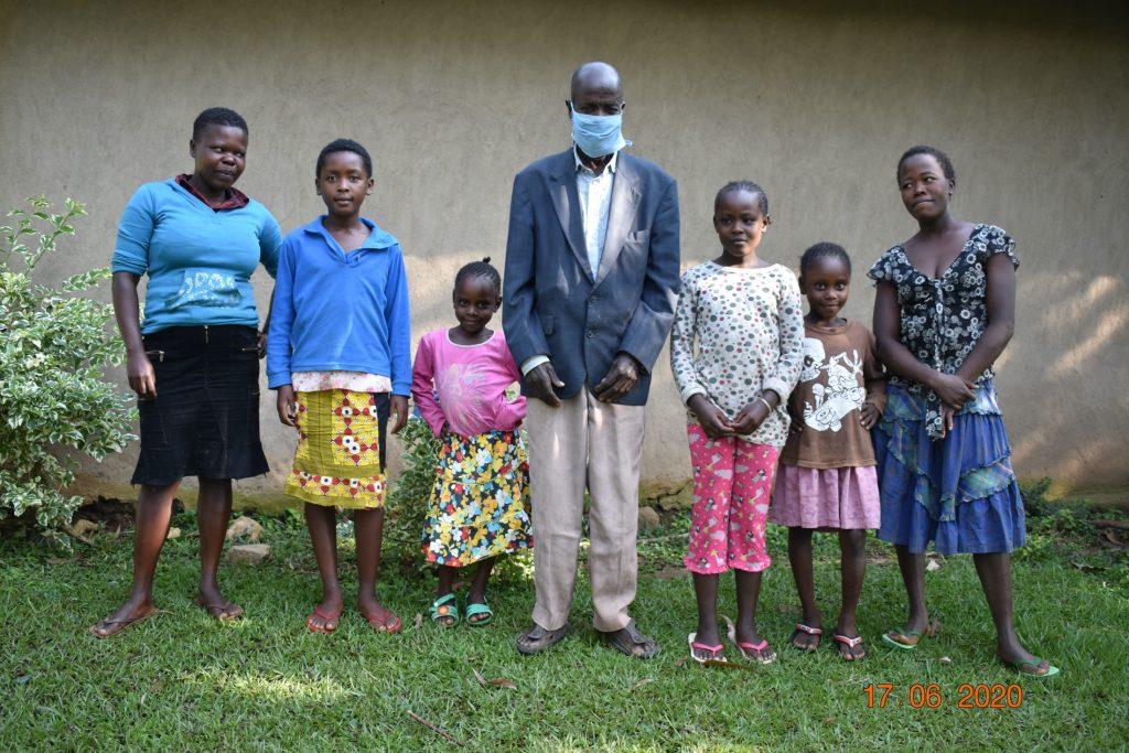 The Water Project : covid19-kenya19178-david-kweyu-with-his-family