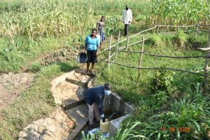 The Water Project:  David Kweyu With Other Water Users