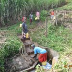 The Water Project: Ataku Community, Ngache Spring -  Catherine And Grandchildren Fetching Water