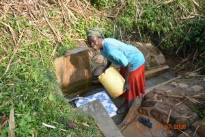 The Water Project:  Catherine Fetches Water At Ngache Spring