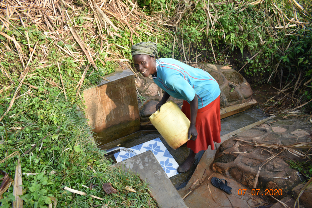 The Water Project : covid19-kenya19179-catherine-fetches-water-at-ngache-spring