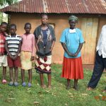 The Water Project: Ataku Community, Ngache Spring -  Catherine With Her Husband And Grandchildren
