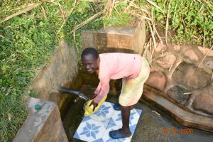 The Water Project:  Catherines Granddaughter Fetching Water From Ngache Spring