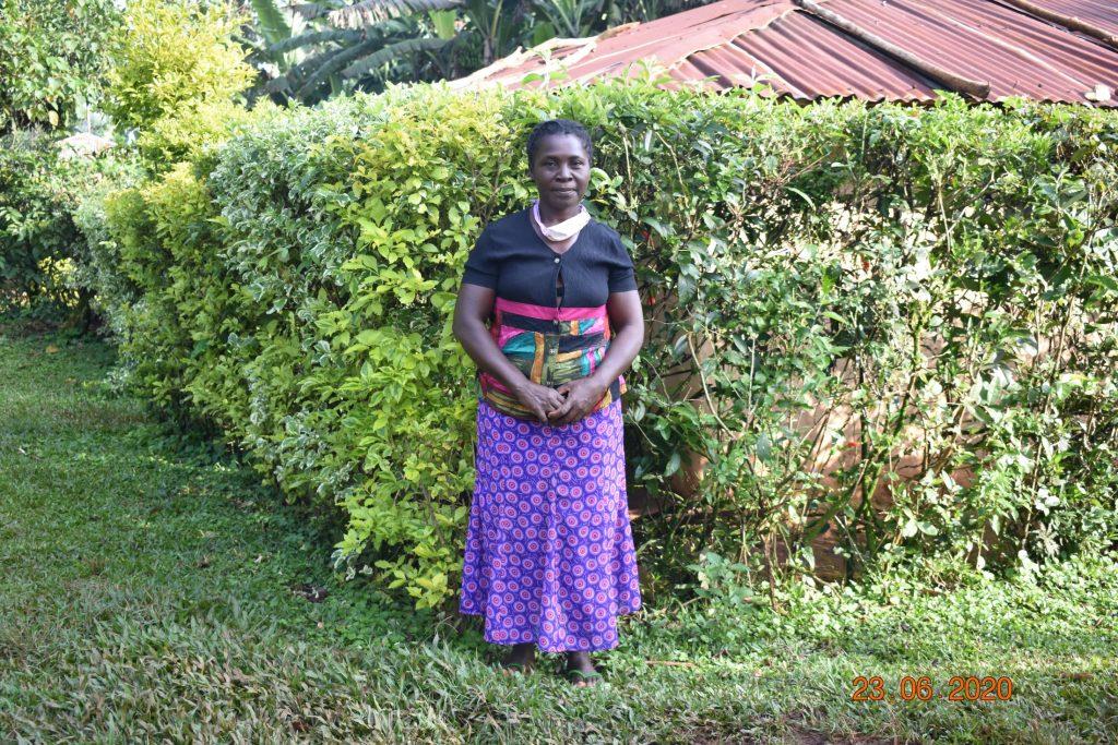 Serilah Nyawanga stands outside her homestead to greet us.