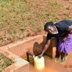 The Water Project: Shikhombero Community, Atondola Spring -  Serilah Fetching Water At Atondola Spring