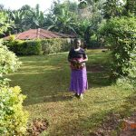 The Water Project: Shikhombero Community, Atondola Spring -  Serilah Outside Her Home