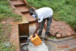 The Water Project:  Simon Mulongo Fetching Water At Marko Spring