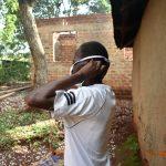 The Water Project: Busichula Community, Marko Spring -  Simon Mulongo Puts On His Mask
