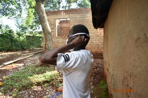 The Water Project:  Simon Mulongo Puts On His Mask