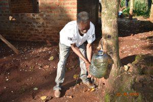 The Water Project:  Simon Mulongo Washing His Hands