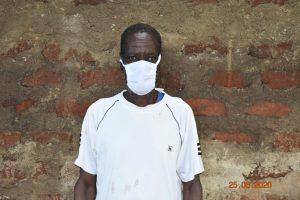The Water Project:  Simon Mulongo Wearing His Mask