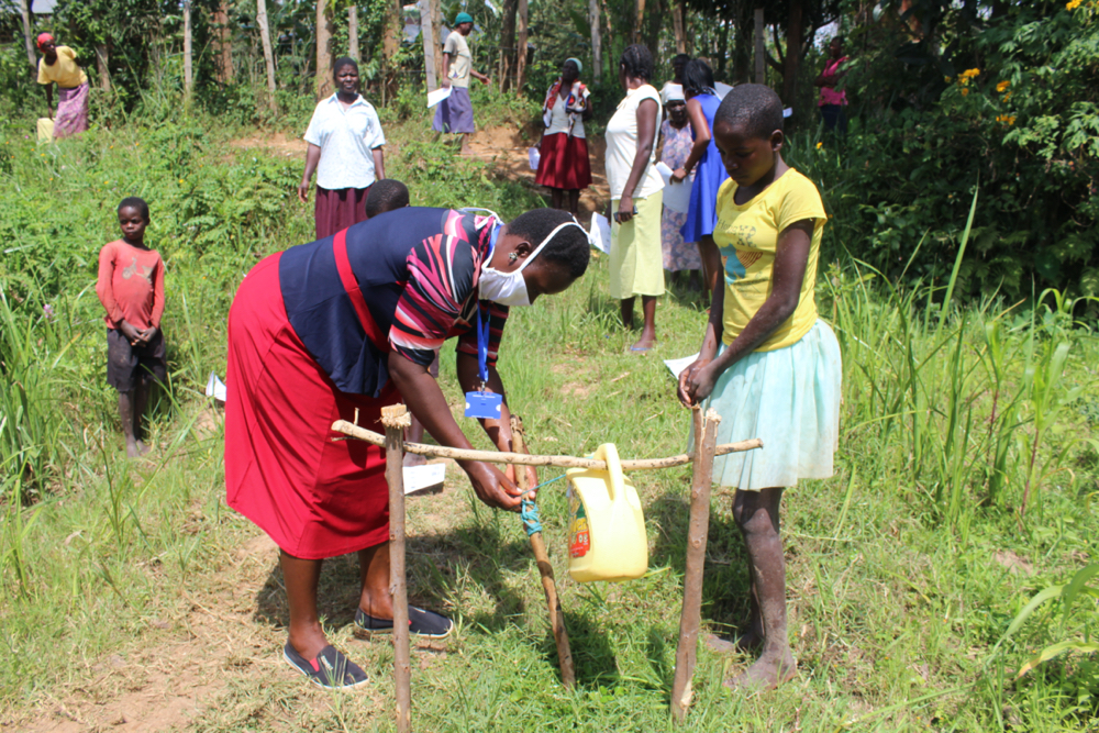 The Water Project : covid19-kenya4431-handwashing-using-an-improvised-handwashing-station-1