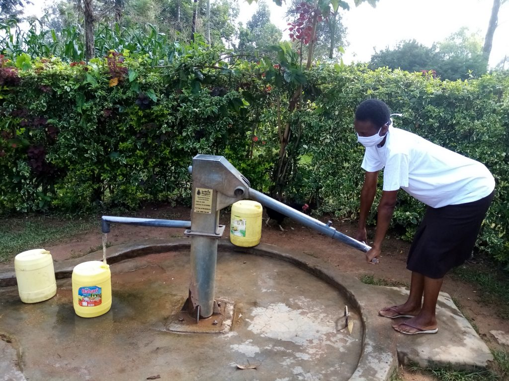 The Water Project : covid19-kenya446-ruth-vuyanzi-fetching-water