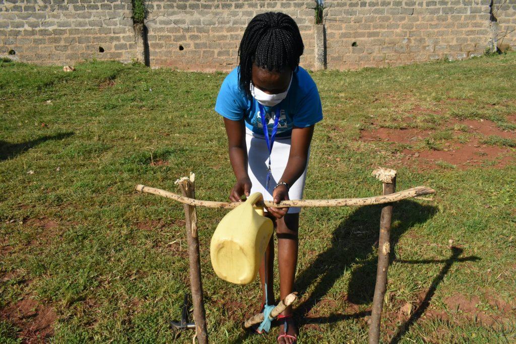 The Water Project : covid19-kenya4571-installing-handwashing-station