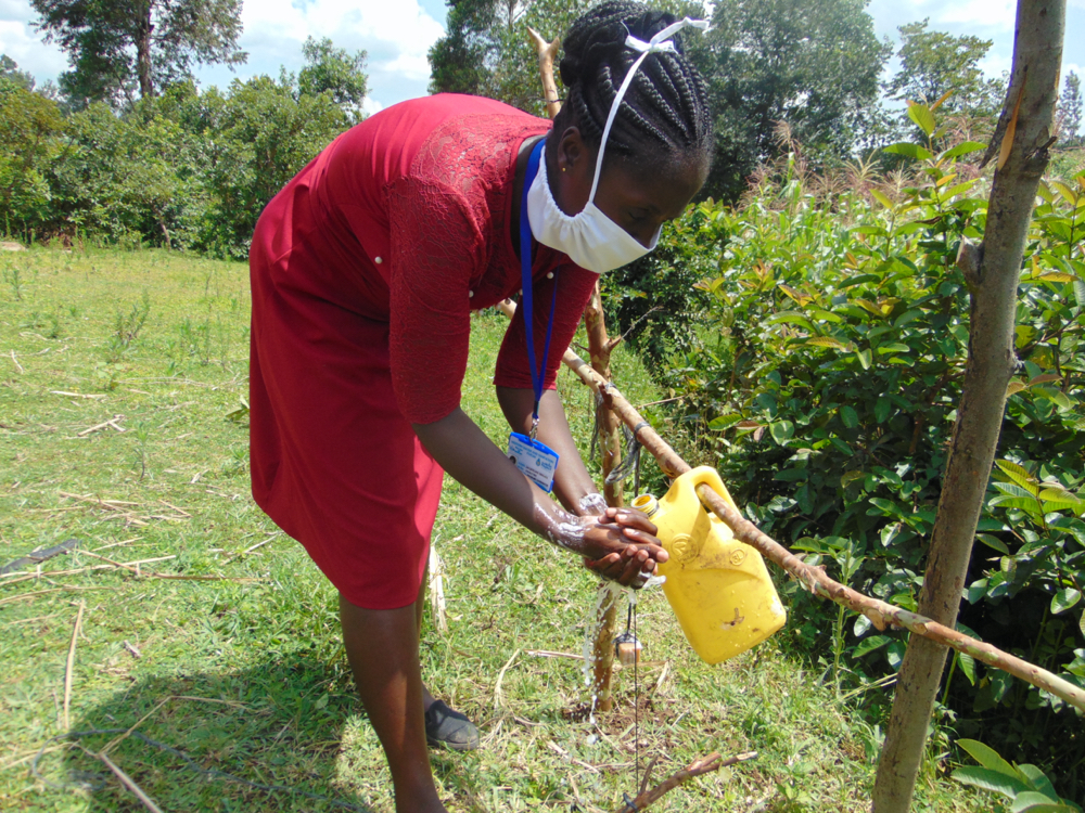 The Water Project : covid19-kenya4589-ensure-you-rinse-your-hands-using-running-water