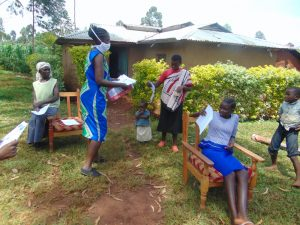 The Water Project:  Mrs Wagaka Issuing Out The Training Documents