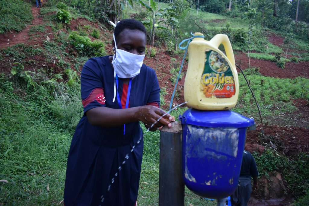 The Water Project : covid19-kenya4703-handwashing-using-leaky-tin
