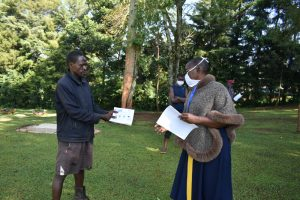 The Water Project:  A Facilitator Explains A Handout To A Participant