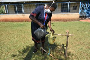 The Water Project:  Filling Handwashing Station With Water